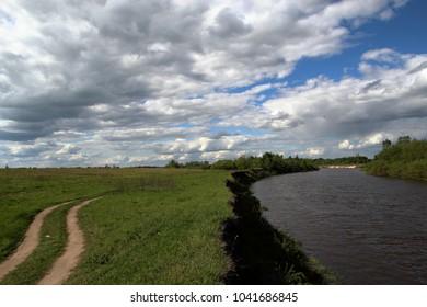 A road along a river.