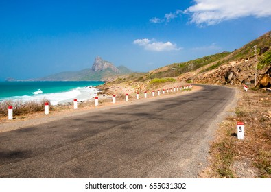 Road along the turquoise sea white sand and rocky under sunshine very beautiful nature at Bai nhat beach Condao island - Vietnam.