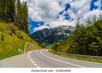 Road among Alps mountains, Klosters-Serneus, Davos,  Graubuenden Switzerland