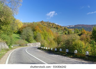 road in autumn landscape, Romania