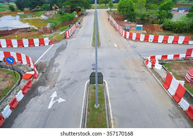 Road barriers erected along the work in progress construction area.