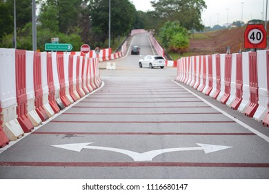 Road barriers erected at the cross junction for road upgrading work.