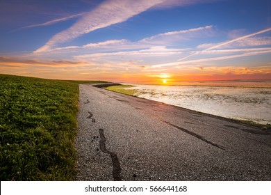 A Road at the beach at sunset