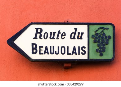 Road of Beaujolais sign on a red wall, France