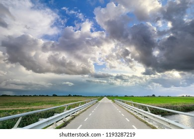road and beautiful blue sky with clouds, Holland