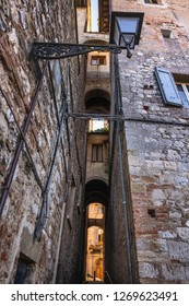Road behind the walls with the pedestrian access gallery to the medieval village of Colle di Val d'Elsa, Siena, Tuscany