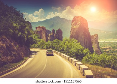 Road bend and a mountain range near Kalambaka. View of the Holy Monastery of Rousanou. Meteora monasteries. Greece. Europe. UNESCO World Heritage List. Vintage effect.