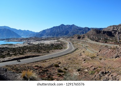 A road between arid mountains.