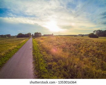road between fields, sunset, beautiful sky