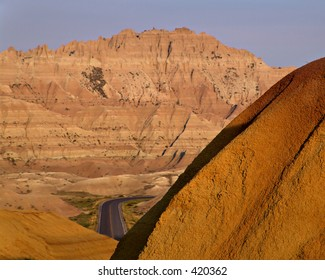 road between the mountains in badlands national park, south dakota