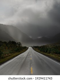 road between mountains in sunset time, Lofoten island,  nice seen while driving through Norway, alone driving, heavy rain in the higt mountains In Lofoten. hight speed i beautiful landscape