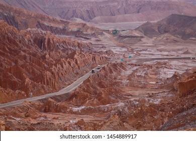 The road between San Pedro de Atacama and Calama. View of the landscape of the Atacama Desert. The rocks of the Mars Valley (Valle de Marte) and Cordillera de la Sal, Atacama Desert, Chile