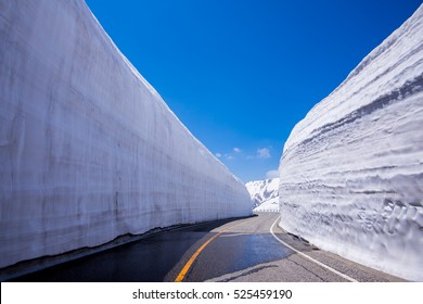Road between Snow wall at Tateyama Kurobe Alpine Route, Japan destination travel