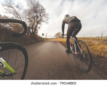 Road bike, pair od cyclists in winter season
