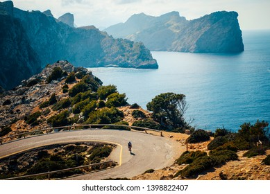 Road bikers on the road on Balearic Islands. Sea in Background. Cap de Formentor. Mallorca, Majorca, Spain