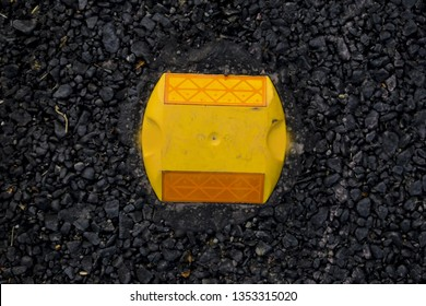 Road blinker or reflector  on edged of bitumen concrete road or flexible pavement