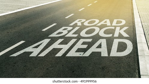 Road block ahead message on the highway lane, traffic signs and markings