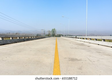 road and blue sky, yellow line on way