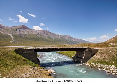 Road bridge crossing river of the mountains in Kyrgyzstan