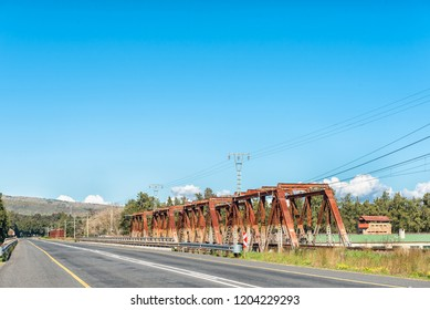 The road bridge and historic railway bridge over the Breede River at Wolseley in the Western Cape Province. The historic blockhouse is visible