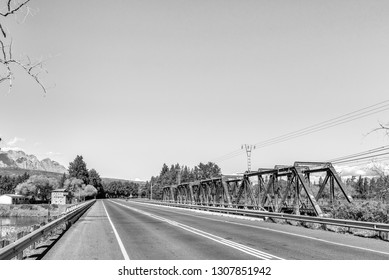 The road bridge and historic railway bridge over the Breede River at Wolseley in the Western Cape Province. The historic blockhouse is visible. Monochrome