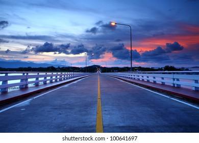 Road bridge on the sea at sunrise, Thailand