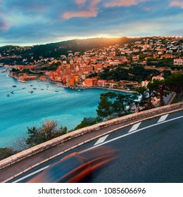 Road and car above Villefrance sur Mer in French Riviera.