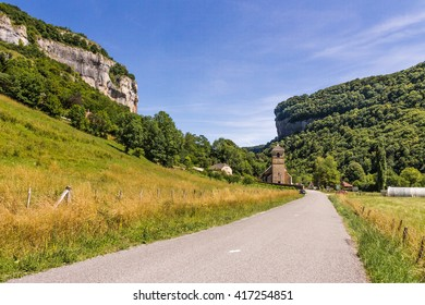 Road and castle in valley. Chalon, Departement Jura, Franche-Comte, France