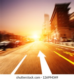 road in city with sunset