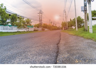 Road in city with sunset, Road under sun heat with building include nature.
