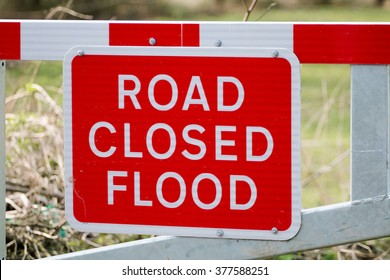 Road Closed Flood Warning Sign on Barrier