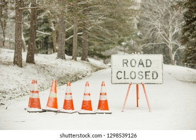 Road Closed Sign on Snow Covered Road