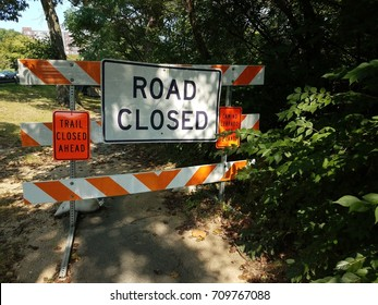 road closed and trail closed ahead signs