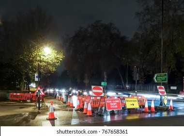 Road closure and diversion signs on the Embankment along the Thames in London