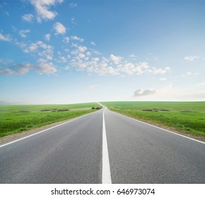 Road and cloudy sky. Beautiful natural concept and idea of travel