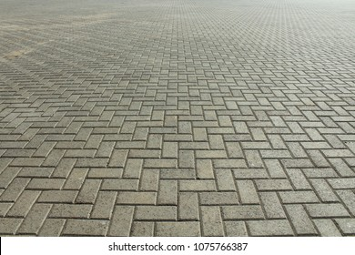The road from the cobblestones in the town square. Background. Texture.