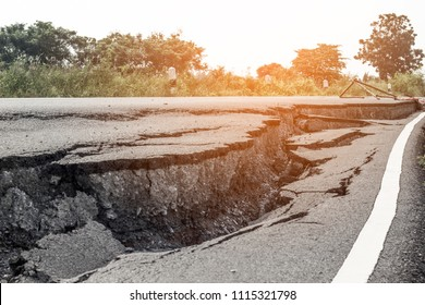 Road collapsed Road subsidence cracking.