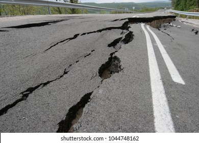 Road collapses with huge cracks. International road collapsed down after bad construction. Damaged Highway Road. Asphalt road collapsed and fallen. Erosion