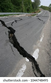 Road collapses with huge cracks. International road collapsed down after bad construction. Damaged Highway Road. Asphalt road collapsed and fallen. Erosion. Vertical