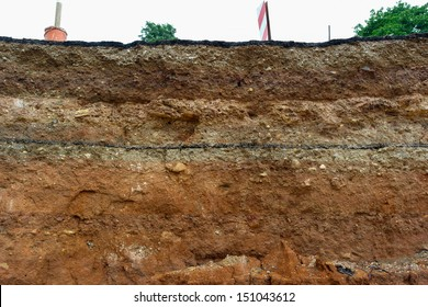 Road collapses.Layer of soil beneath section