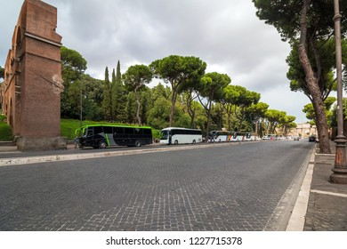 Road to Colosseum in Rome in Italy with buses in background