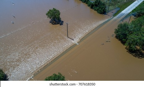 A Road completely covered underwater as Hurricane Harvey Floods Small Town in Texas along the Colorado River in Columbus