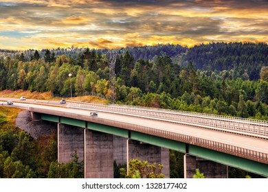 Road with a concrete bridge through forest areas.