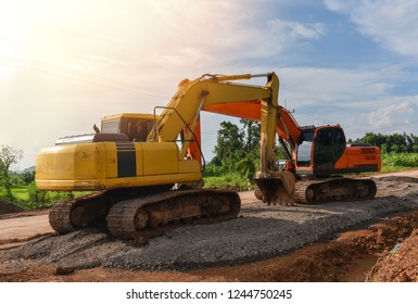 road construction with backhoe / yellow and orange modern tractor loader backhoe digger dual working on construction site