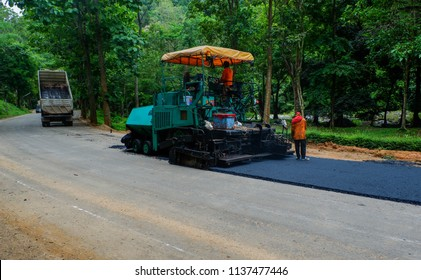 Road construction crew paves a new lane