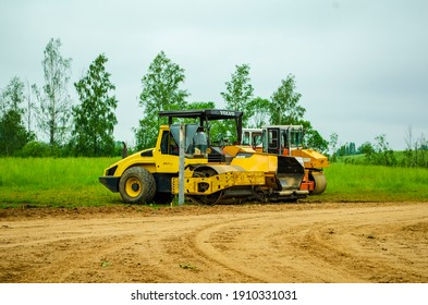road construction machinery stands near the road in storage in Belarus not far from Lake Svir June 15, 2020, birds fly in the sky, this is not rubbish