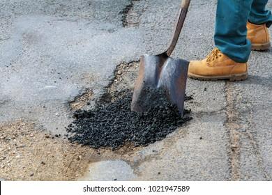 Road construction. New asphalt concrete, concrete kerb and orange safety