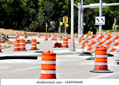 Road construction site with orange barrels new traffic signals soon to be activated and left turn arrows.