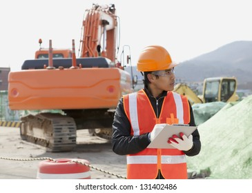 road construction worker and heavy equipment on the background