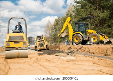 Road construction works with commercial equipment